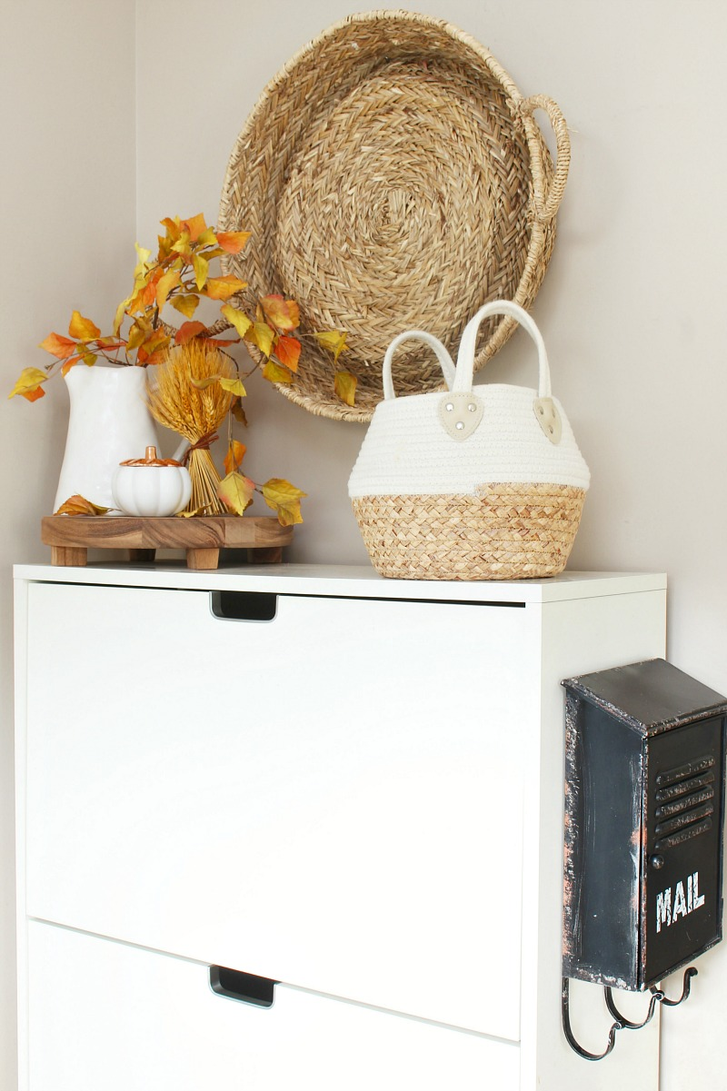 Fall front entryway with Ikea storage bin.