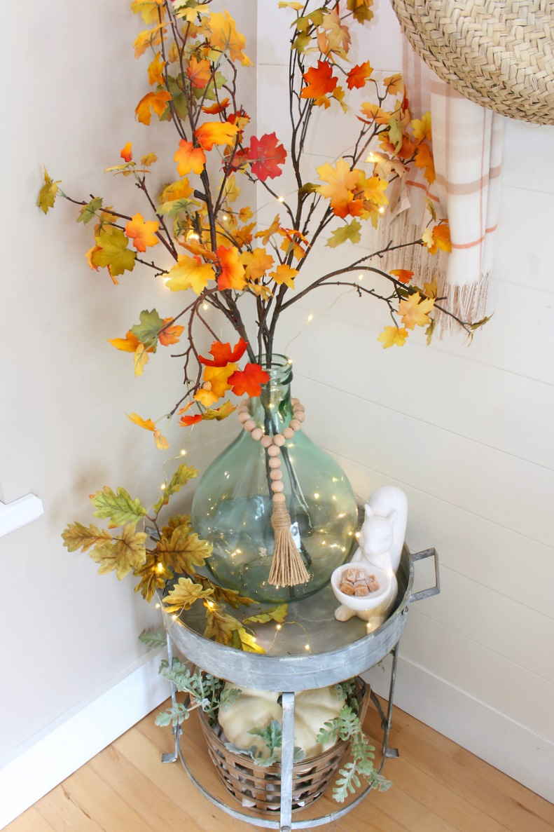 Fall foyer with side table decorated for fall.