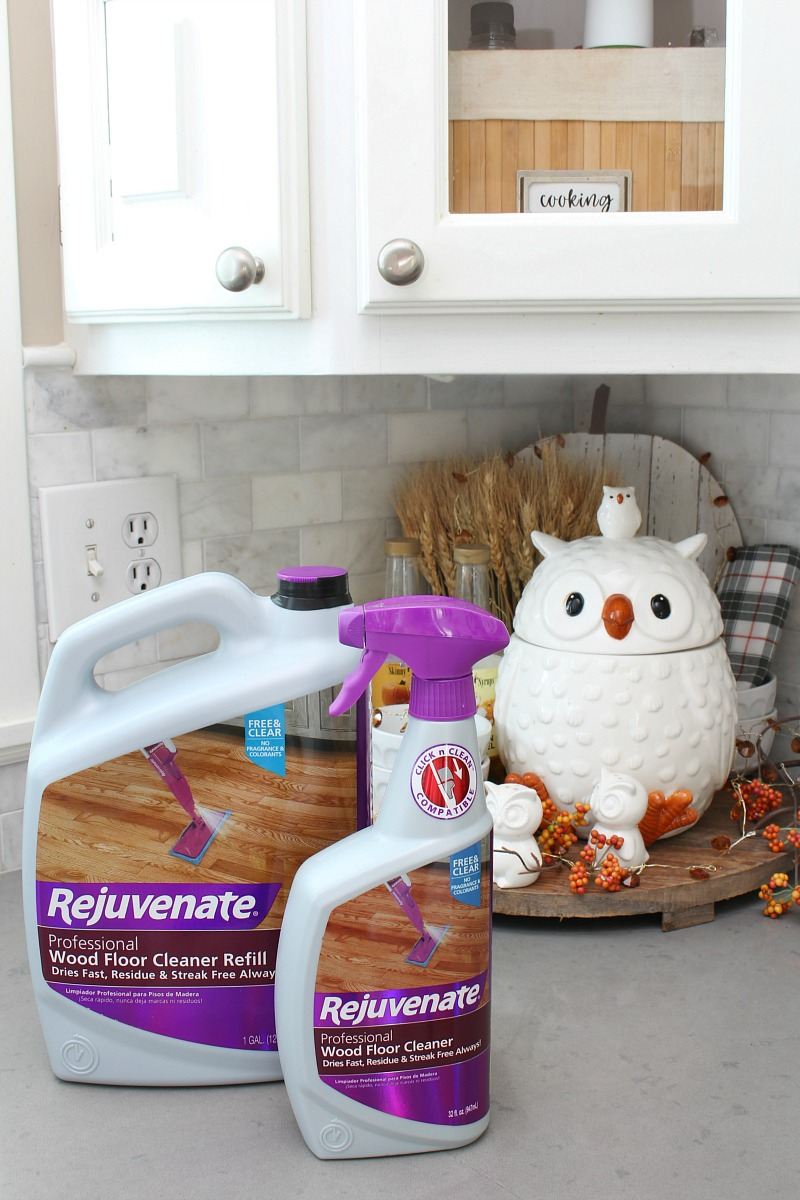 Rejuvenate wood cleaners on a kitchen counter with fall decor.