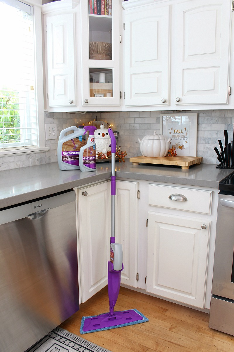 White kitchen decorated for fall with Rejuvenate cleaning products.