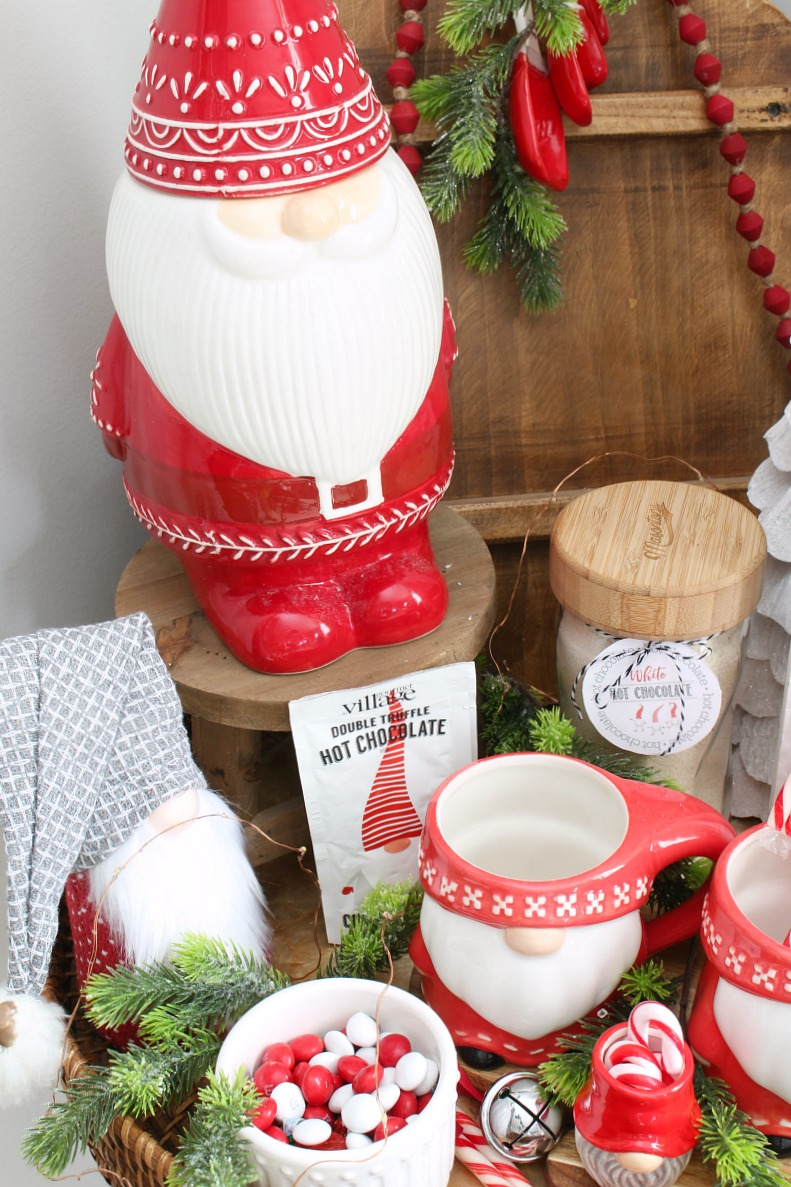 Cute Christmas gnome display with gnome cookie jar and mugs.