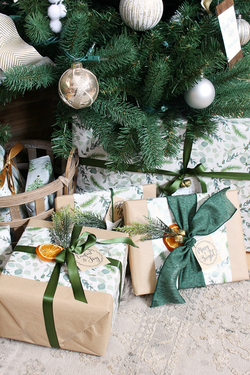 Beautiful gift wrapping in greens and neutrals under a Christmas tree.
