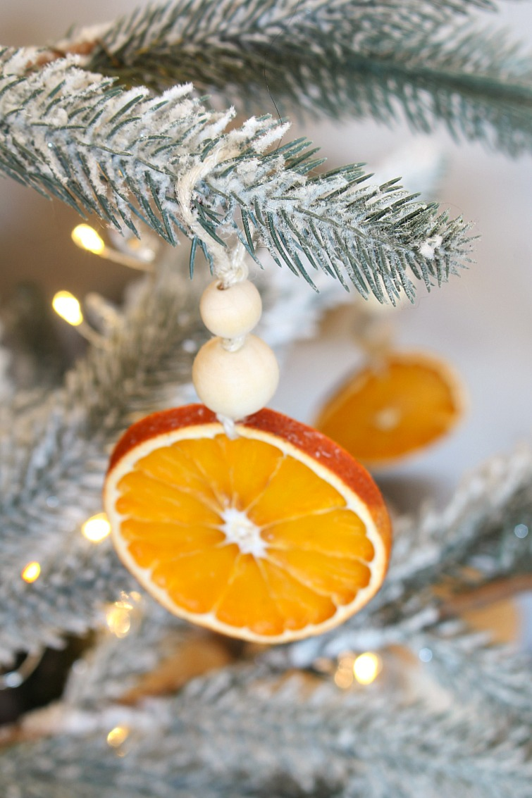DIY dried orange Christmas ornaments with wood beads.