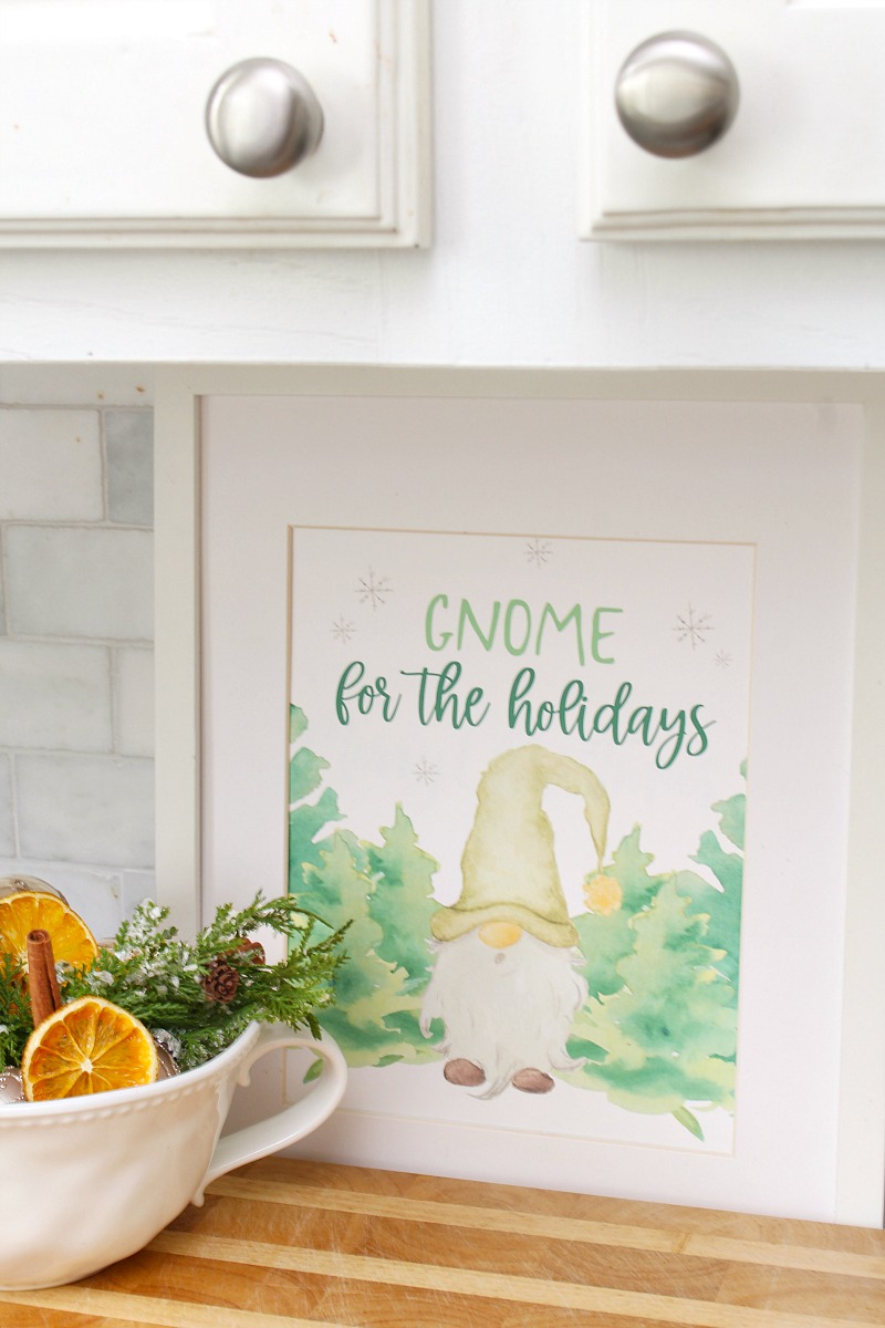 Gnome for the Holidays Christmas printable in a Christmas kitchen.