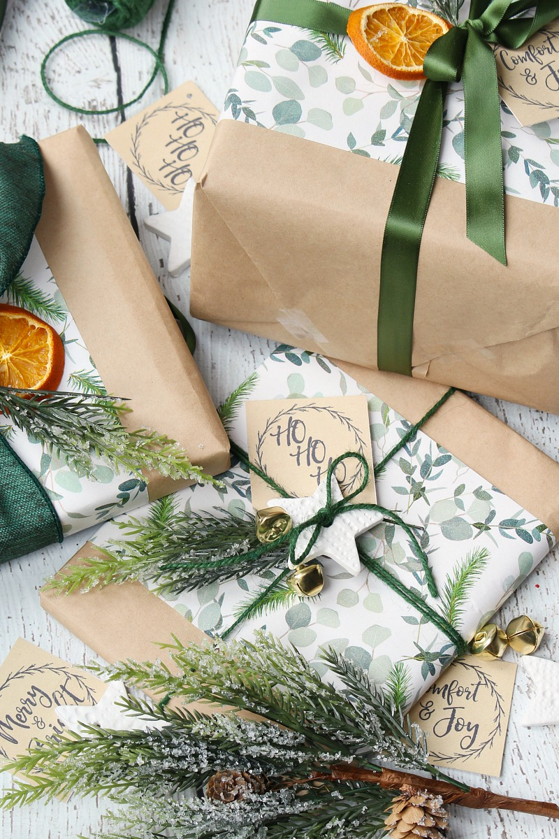 Christmas gift wrapping ideas with greenery and other pretty embellishments.