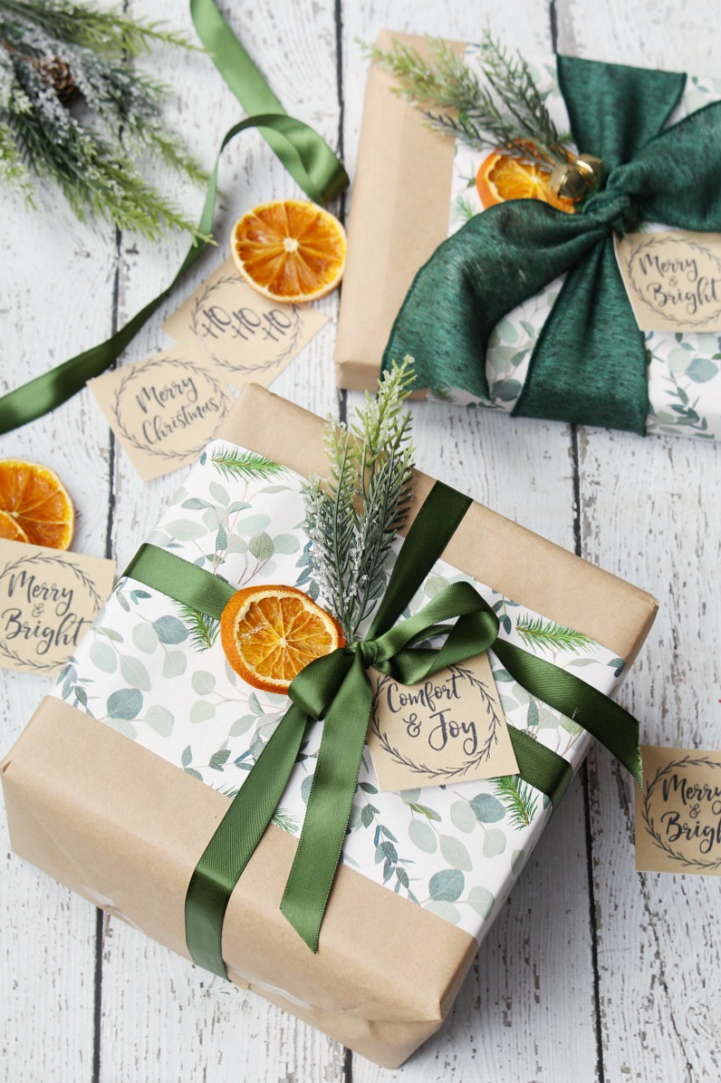 Free kraft paper free printable Christmas gift tags using pops of green and dried oranges.