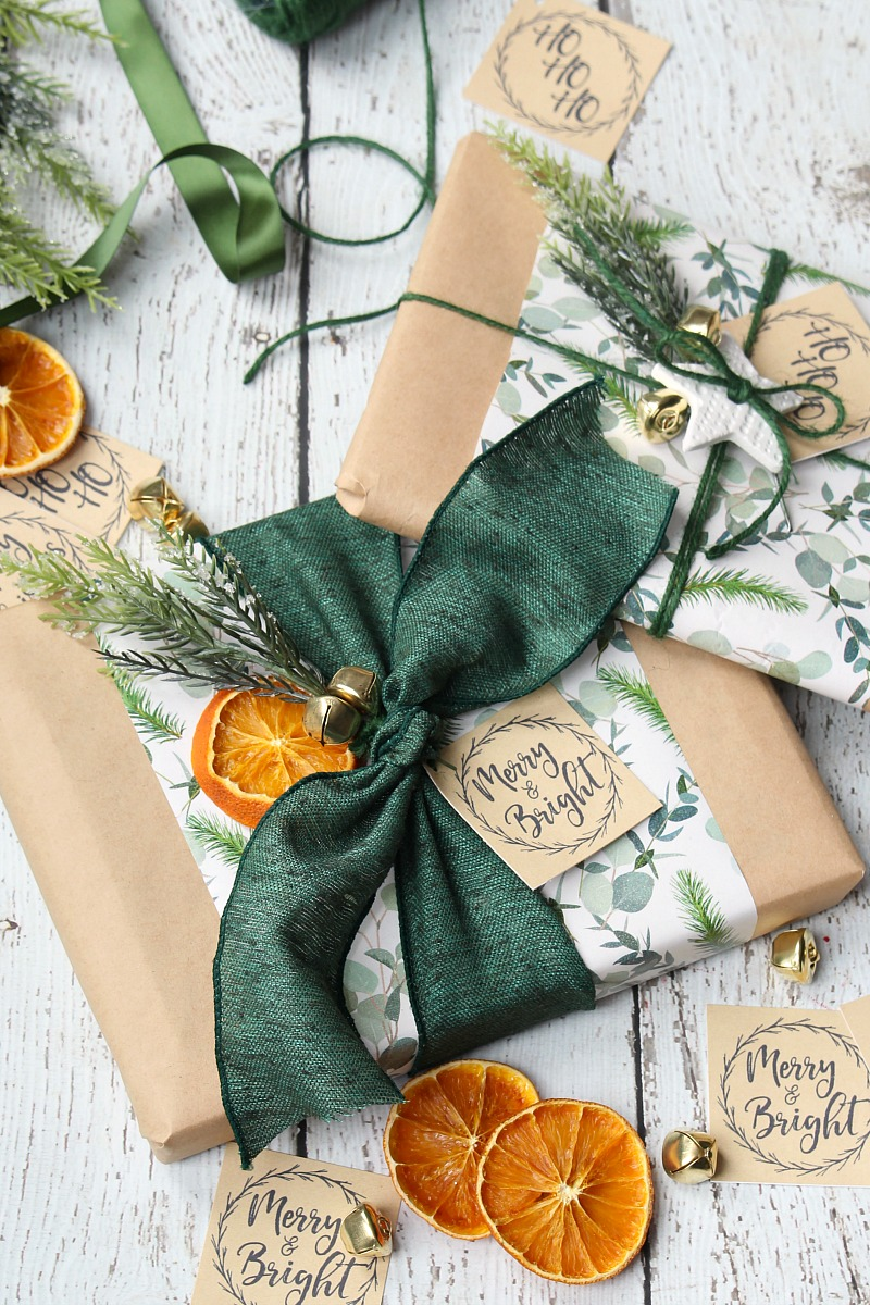 Pretty Christmas packages wrapped with kraft paper and dried oranges.