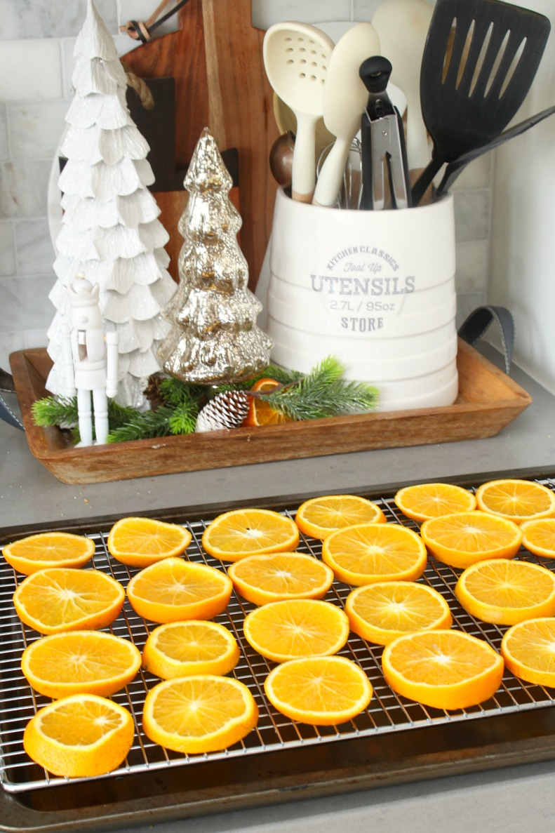 Sliced oranges on a baking sheet to get dried for Christmas decor.