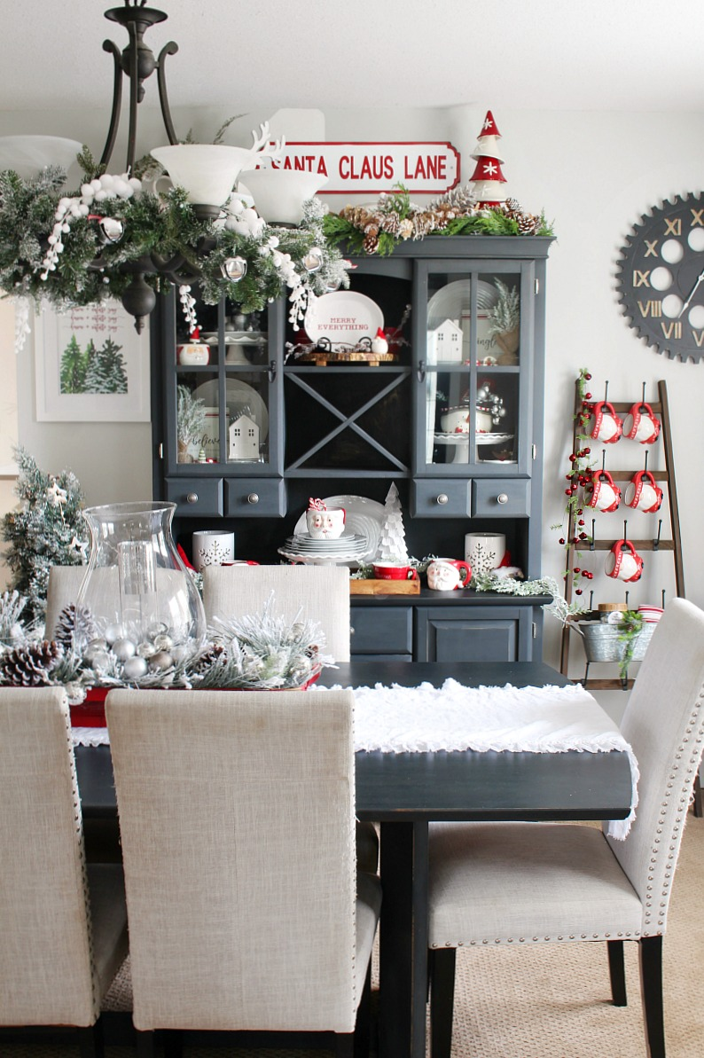 Beautiful Christmas dining room decorated with fun red and white touches.