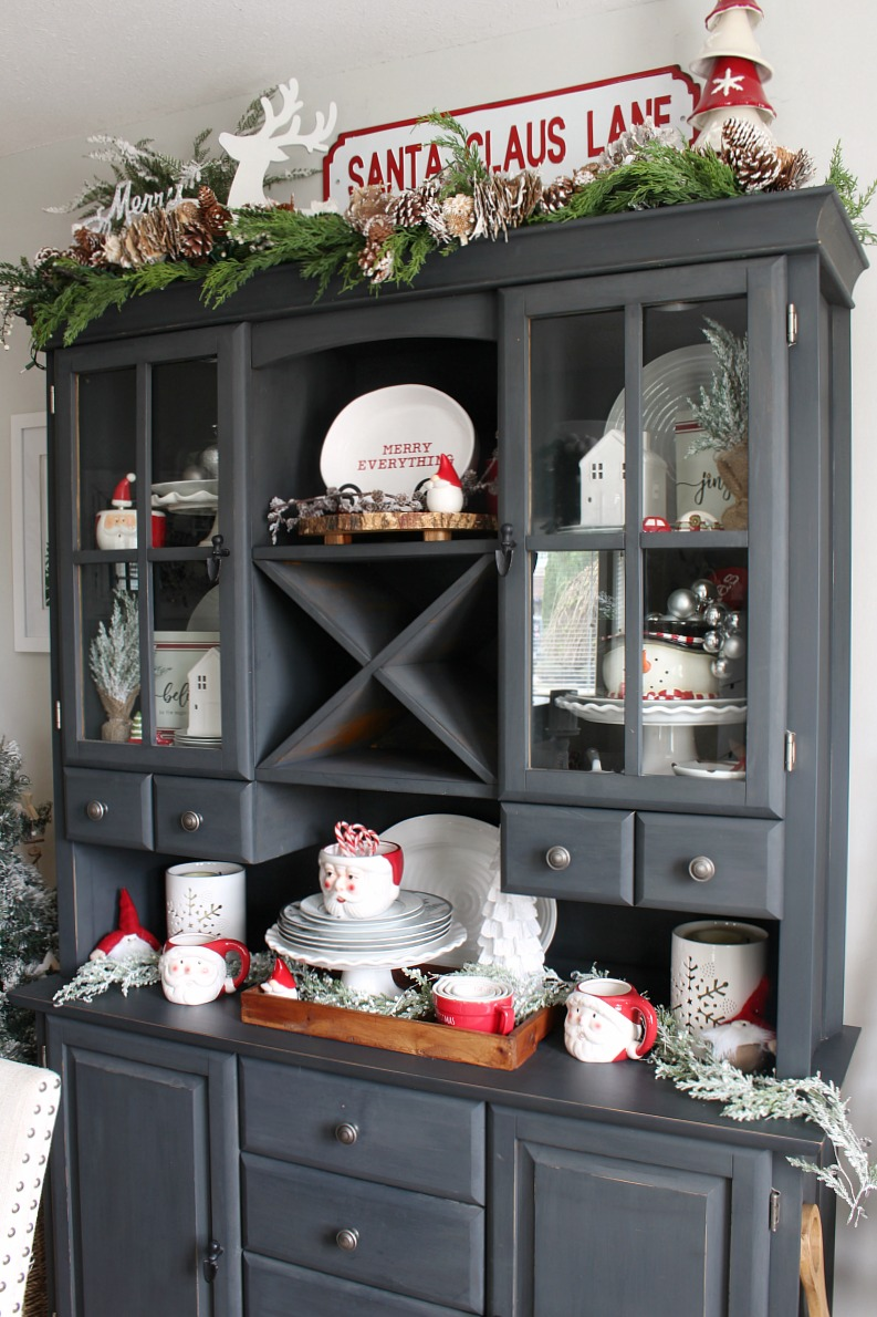 Christmas hutch decorated for Christmas with red and white accents.