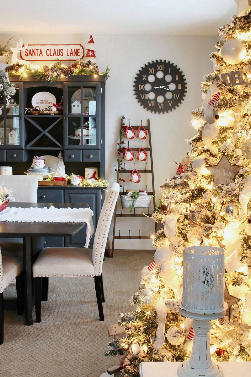 Beautiful Christmas dining room decorated with fun red and white touches and lots of lights.