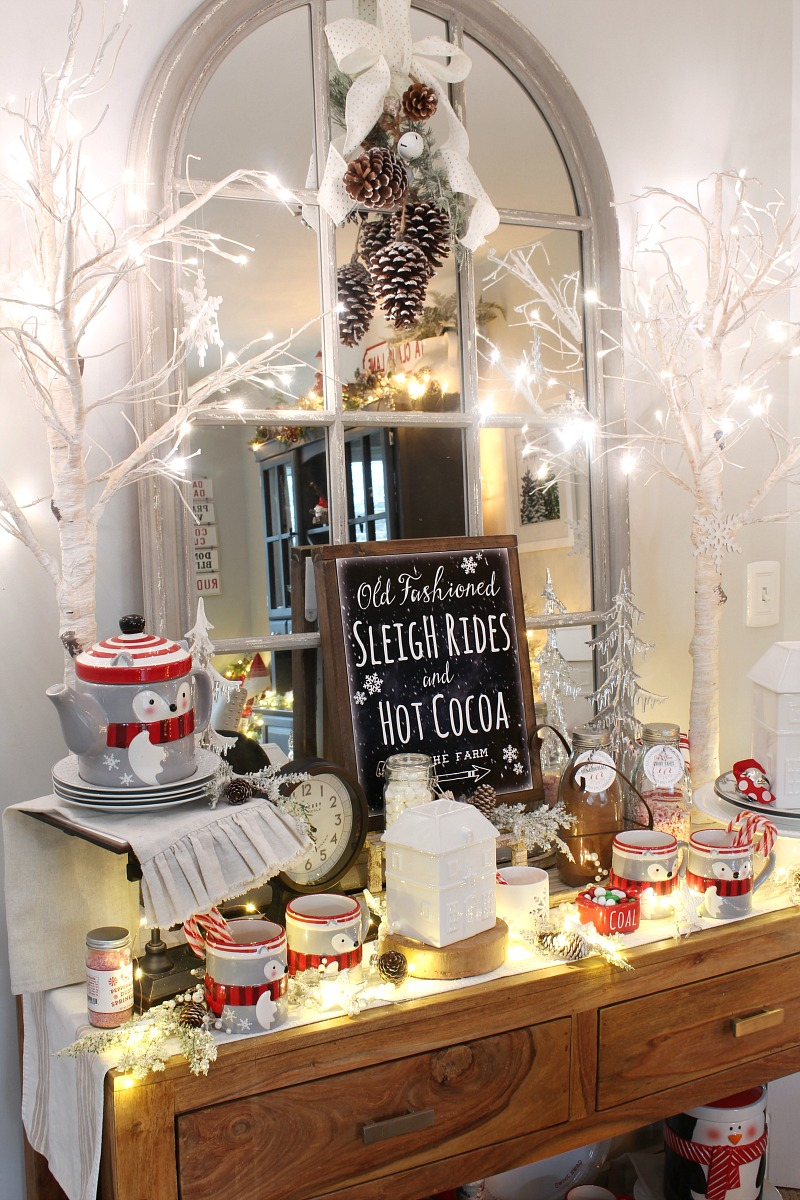 Dining room side board decorated for Christmas with a hot chocolate bar.