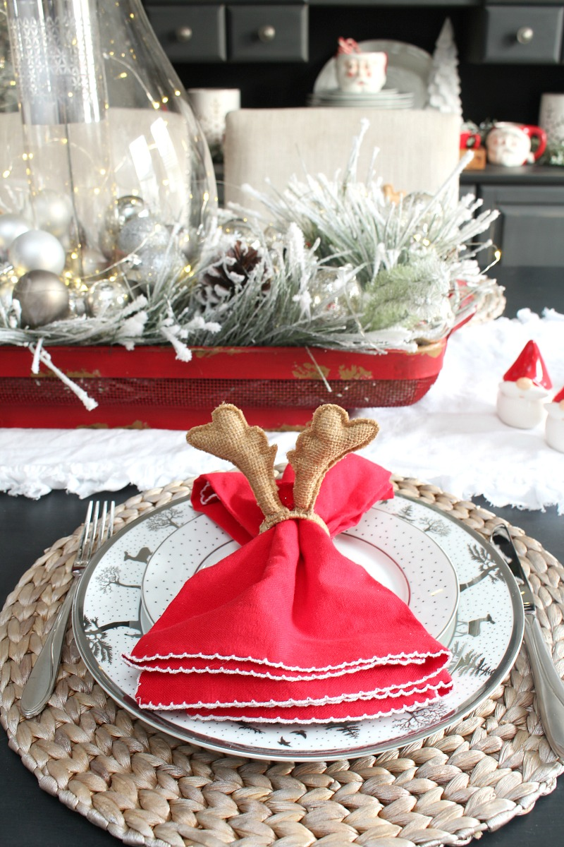 Christmas place setting with Rudolph napkin holders.