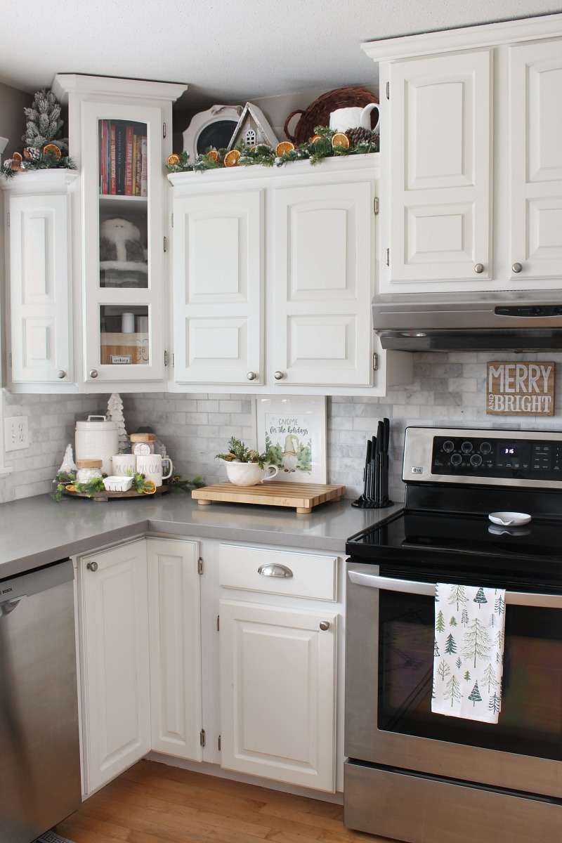 Modern farmhouse style white kitchen with pretty Christmas kitchen decor.