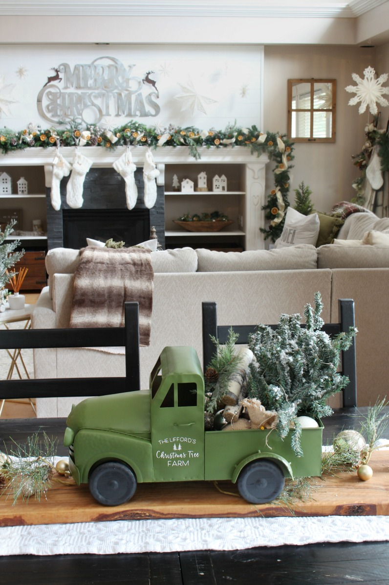 Farmhouse truck Christmas centerpiece on a kitchen table.