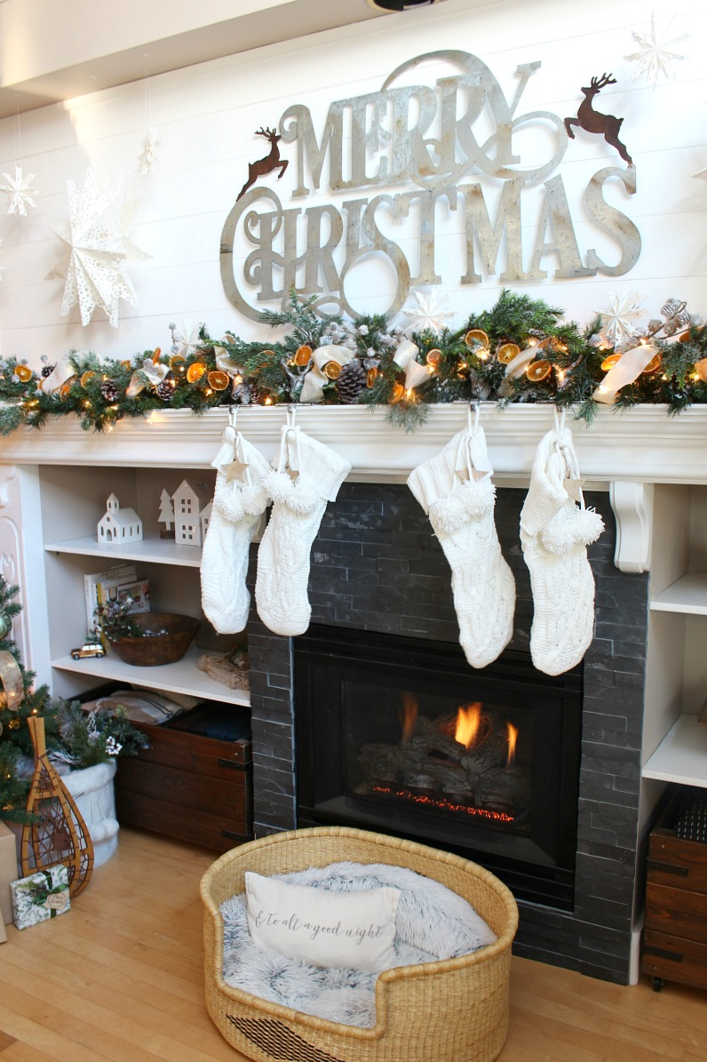 Beautiful Christmas mantel decor ideas and Christmas tree with dried oranges.