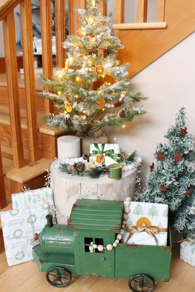 Cute Christmas vignette with a Christmas tree and vintage engine.