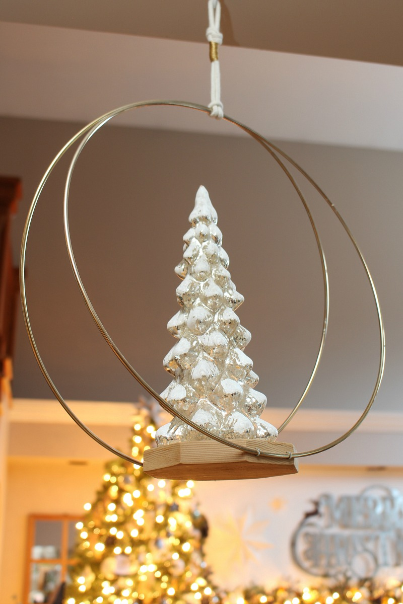Mercury glass Christmas tree on a wood hanging stand.