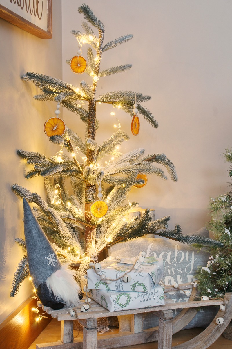 Charlie Brown Christmas tree decorated with handmade orange slice ornaments.