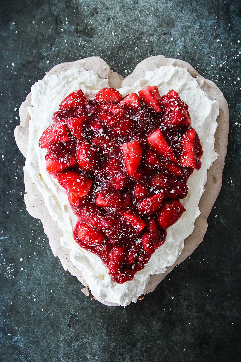 Chocolate pavlova with strawberries shaped as a heart for Valentine's Day.