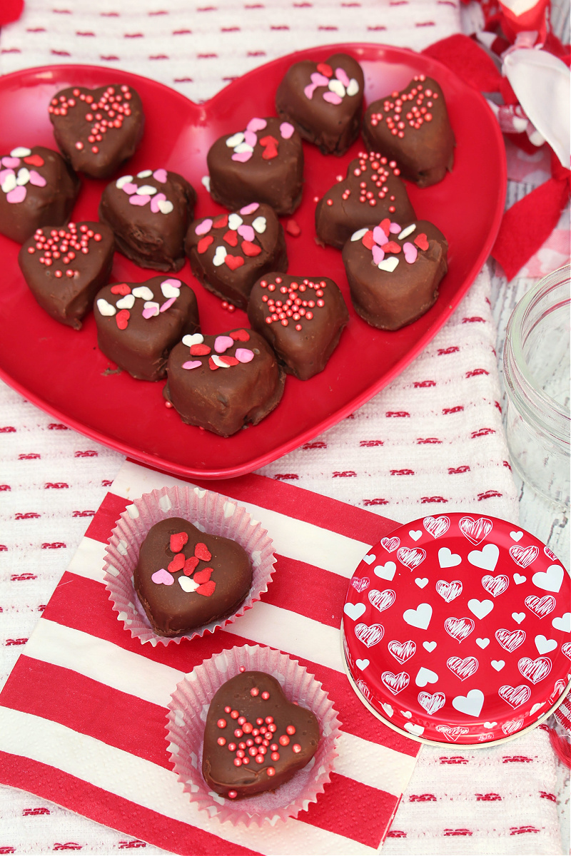 Valentine's Day Oreo truffles on a heart plate.