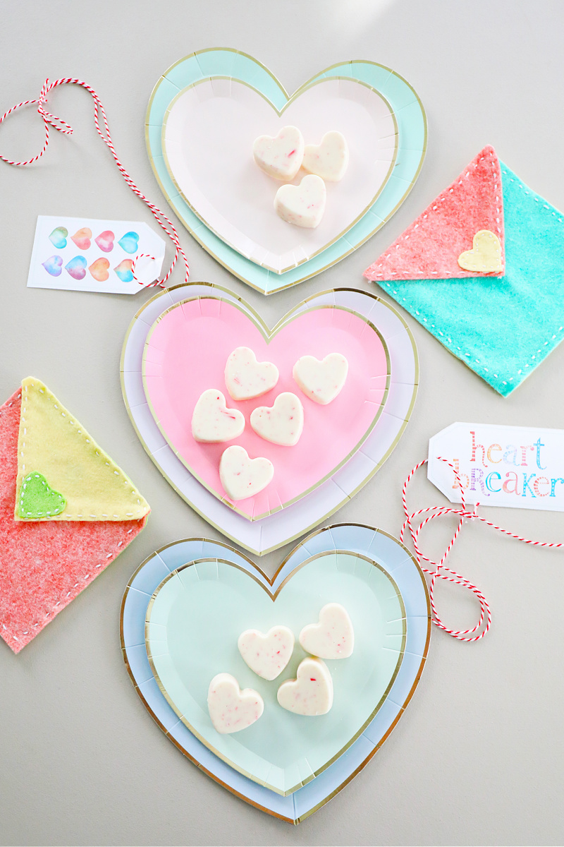 White chocolate peppermint hearts on heart plates with pretty watercolor Valentine's Day tags.
