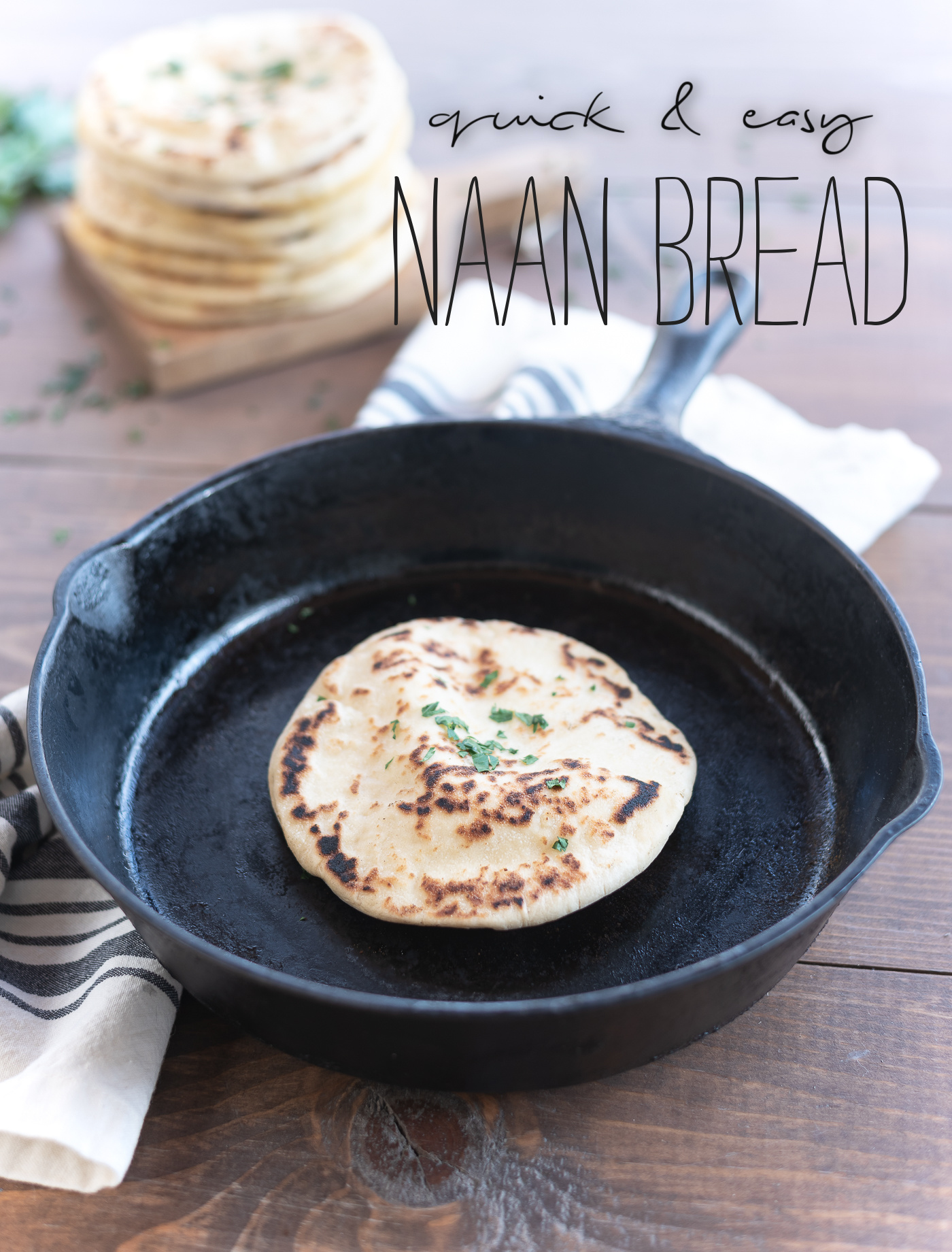 Homemade naan bread in a skillet.