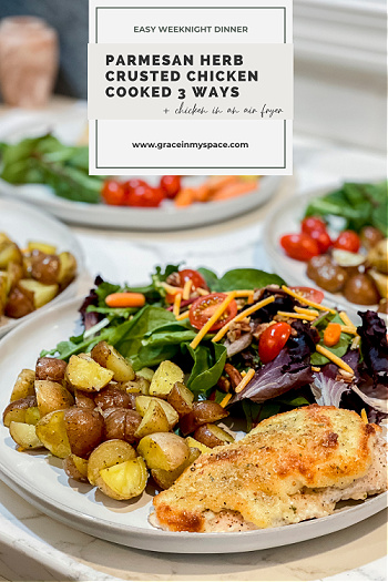 Parmesan herb crusted chicken served with salad and potatoes.