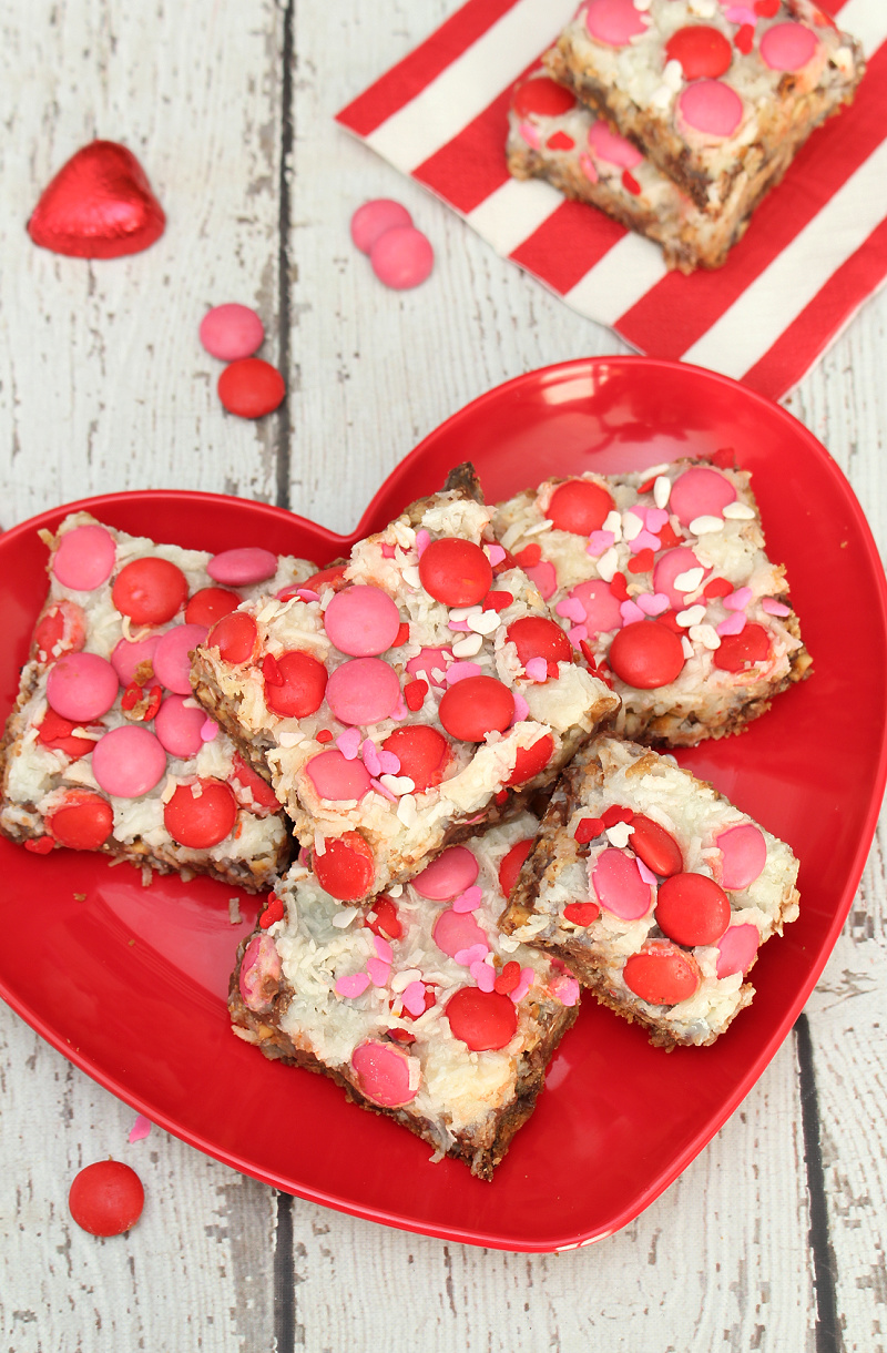 Pink and red magic layer bars on a heart plate for Valentine's Day.