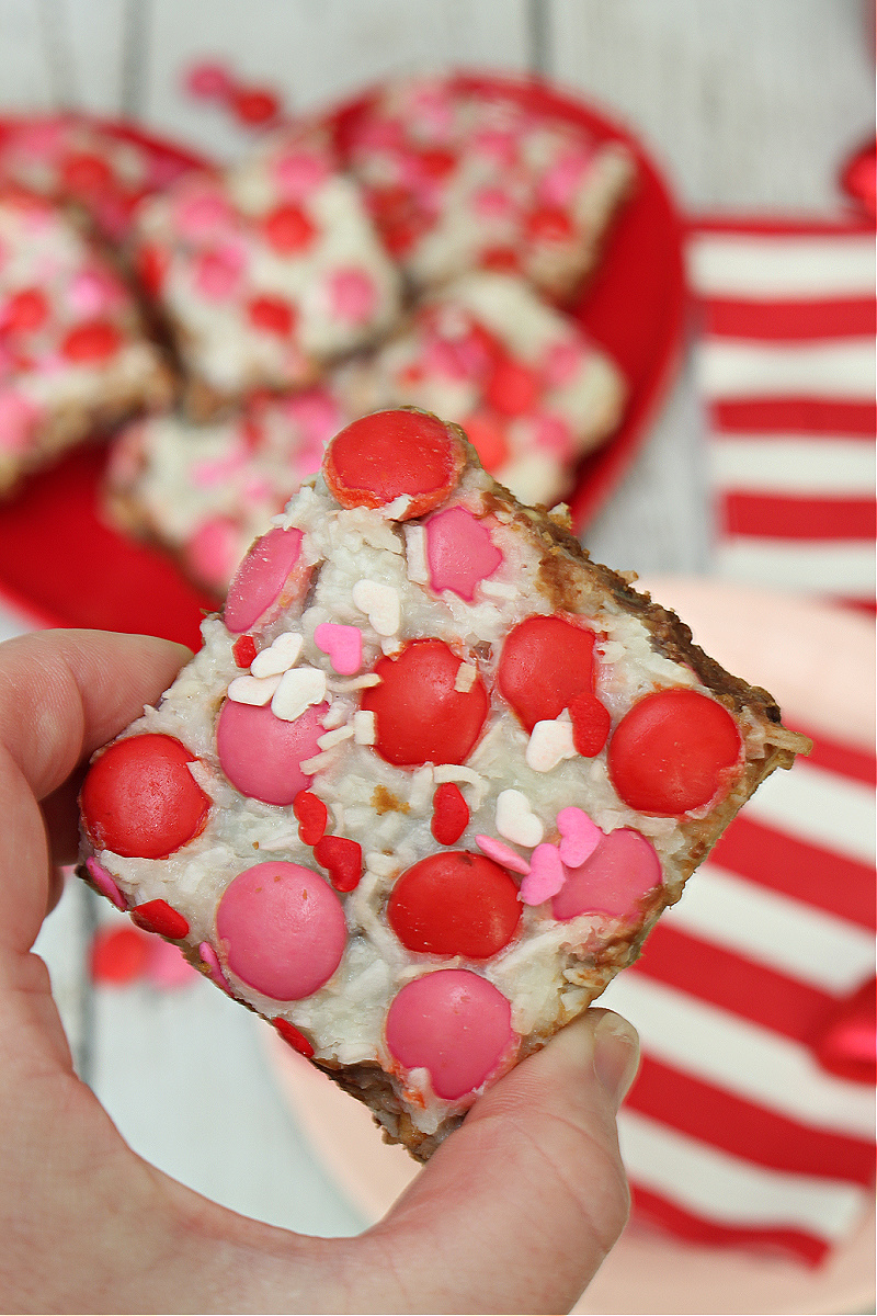Magic layer bar with red and pink chocolate candies for Valentine's Day.