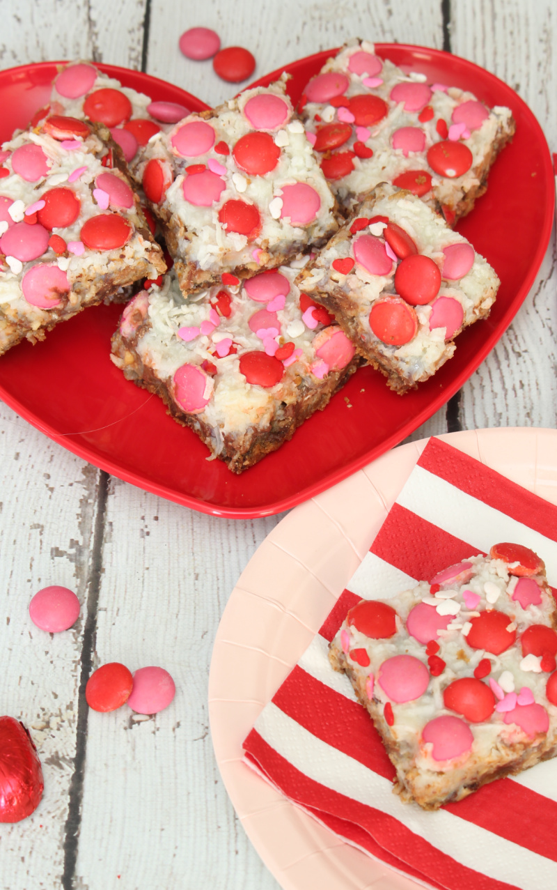 Plate of magic bars using pink and red chocolates for Valentine's Day.