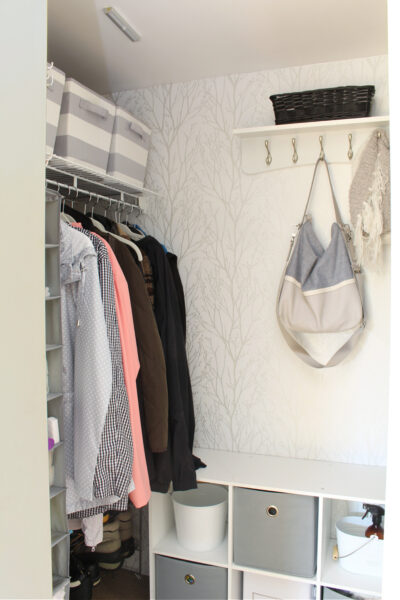 Organized and pretty front entry closet with peel and stick wall paper.