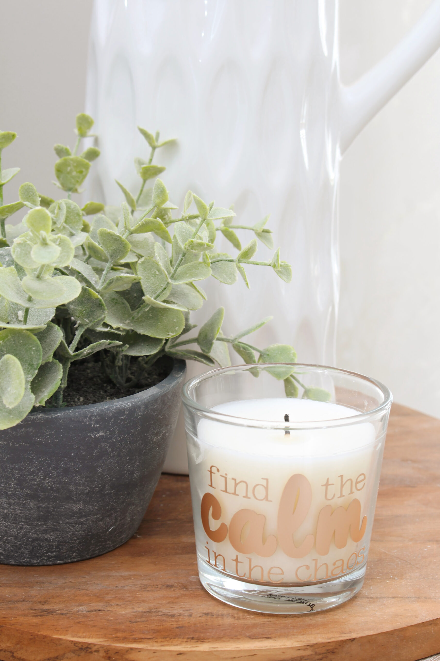 """Find the calm in the chaos"" custom DIY candle on a wood tray."
