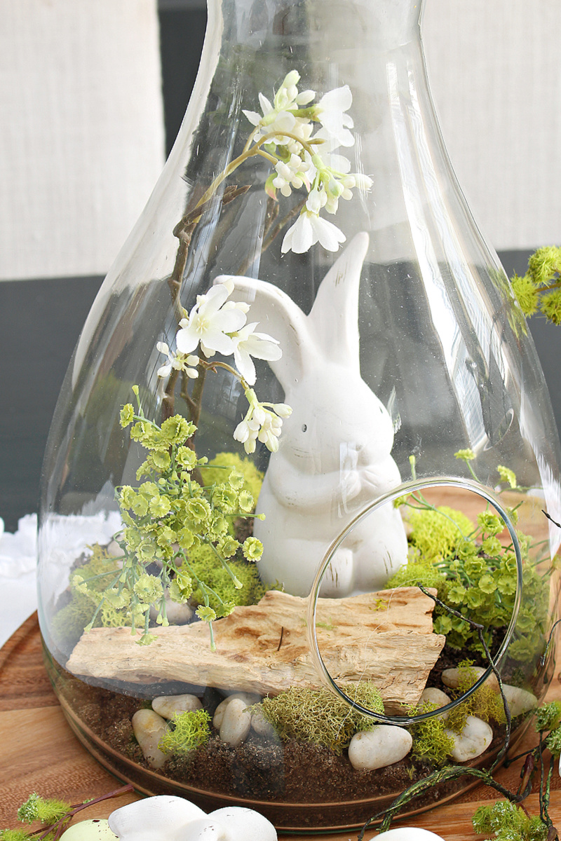 Terrarium decorated for Easter with Easter bunny and natural elements.