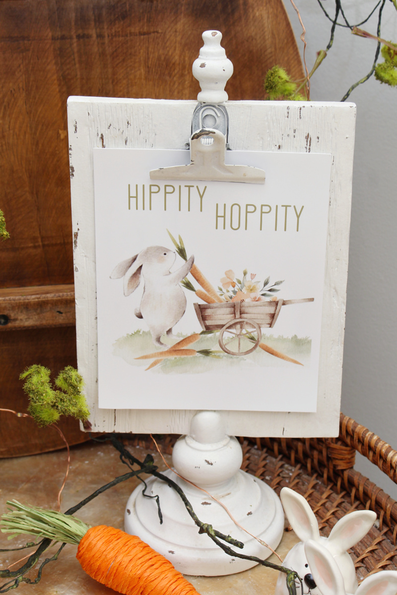 Hippity Hoppity free Easter printable in a white clipboard style frame.