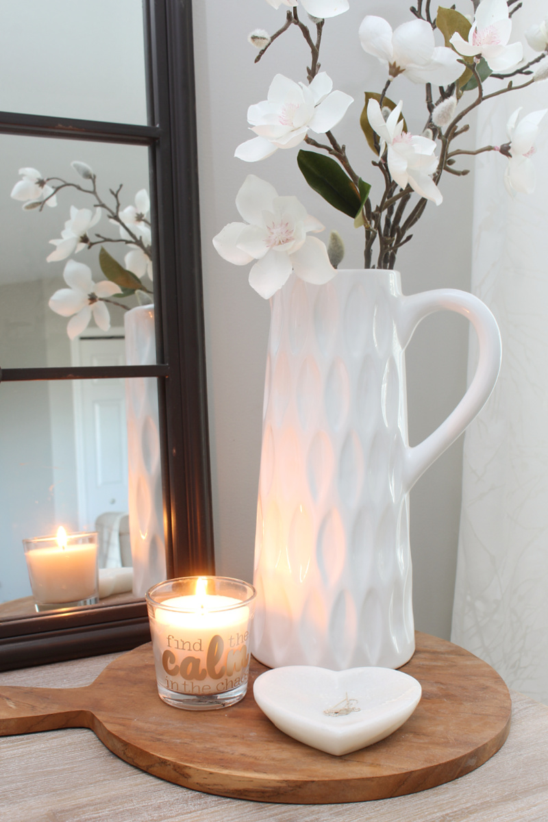 """Find the Calm in the Chaos"" custom candle on a wood tray with white vase."