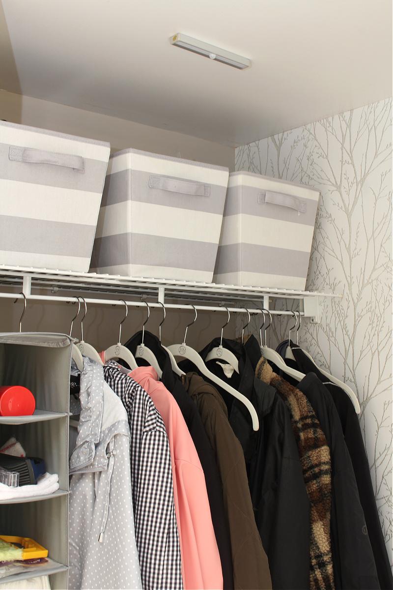 Small closet organization with motion sensor light.