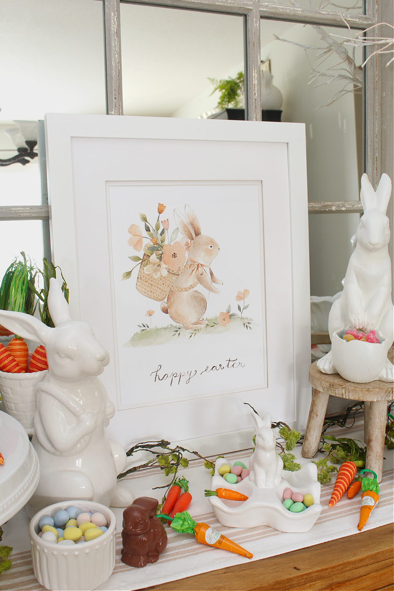 Happy Easter free Easter bunny printable displayed with white ceramic bunnies.