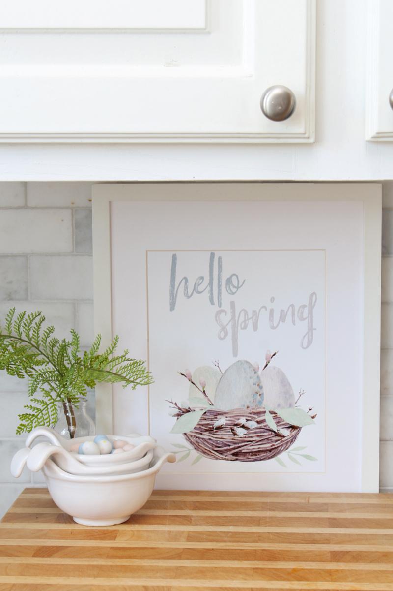 Hello Spring free spring printable on display in a white kitchen.