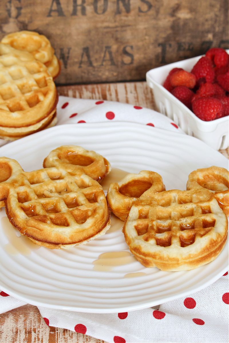 Light and fluffy Mickey waffles with syrup.