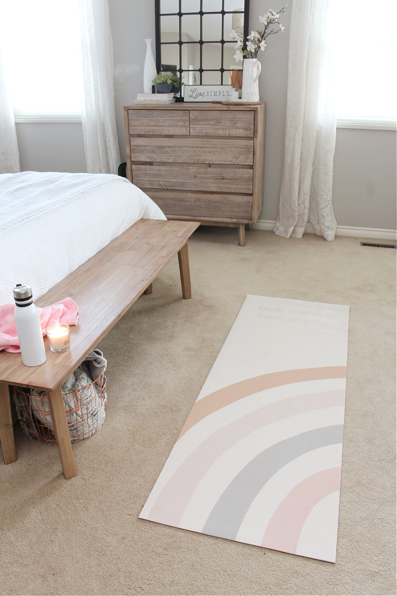 Custom yoga mat in a bedroom space for self-care.