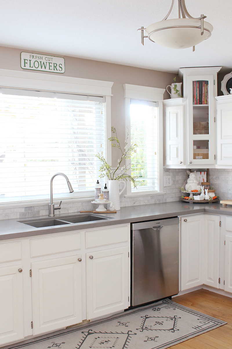 White kitchen decorated for spring.