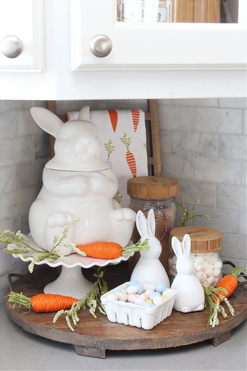 Cute white bunny and carrot Easter vignette.