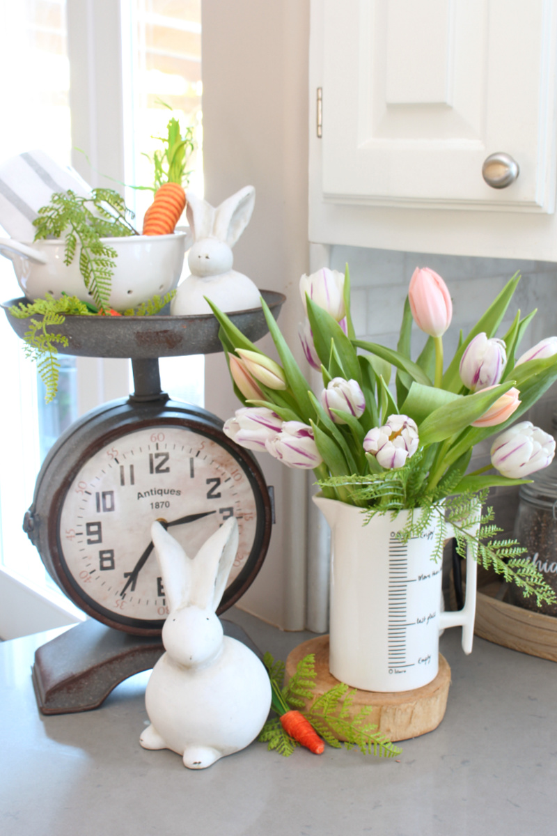 Pretty spring kitchen decor with tulips and white bunnies.
