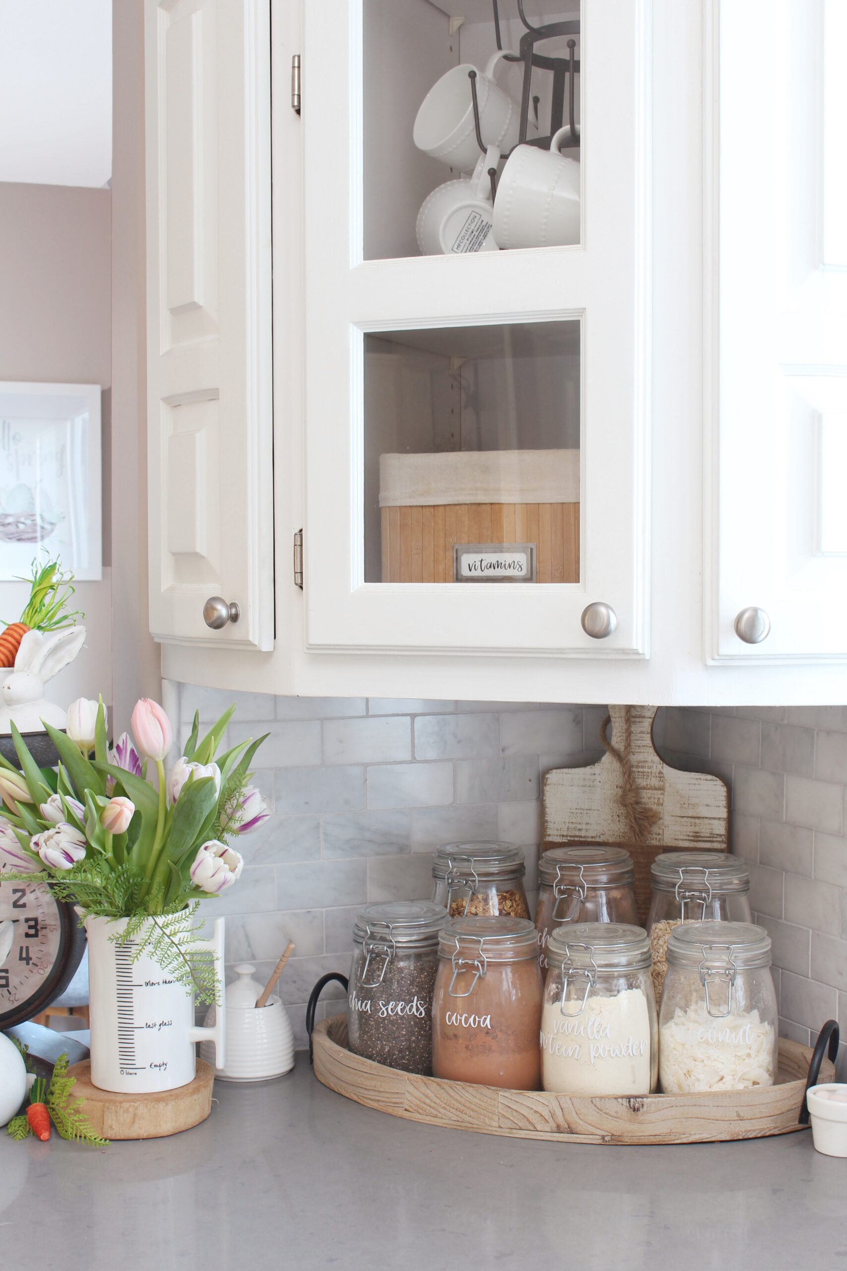 Kitchen corner with glass mason jars filled with dry goods for a smoothie bar.