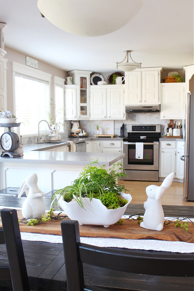 Pretty tropical spring centerpiece in a white kitchen.