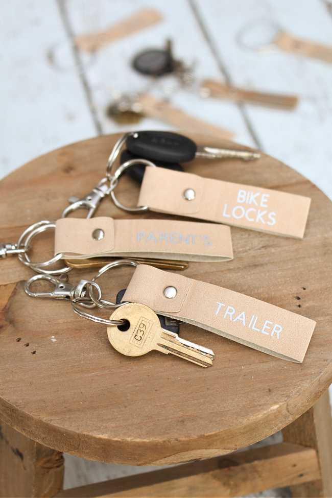 DIY keychains on a wood stand.