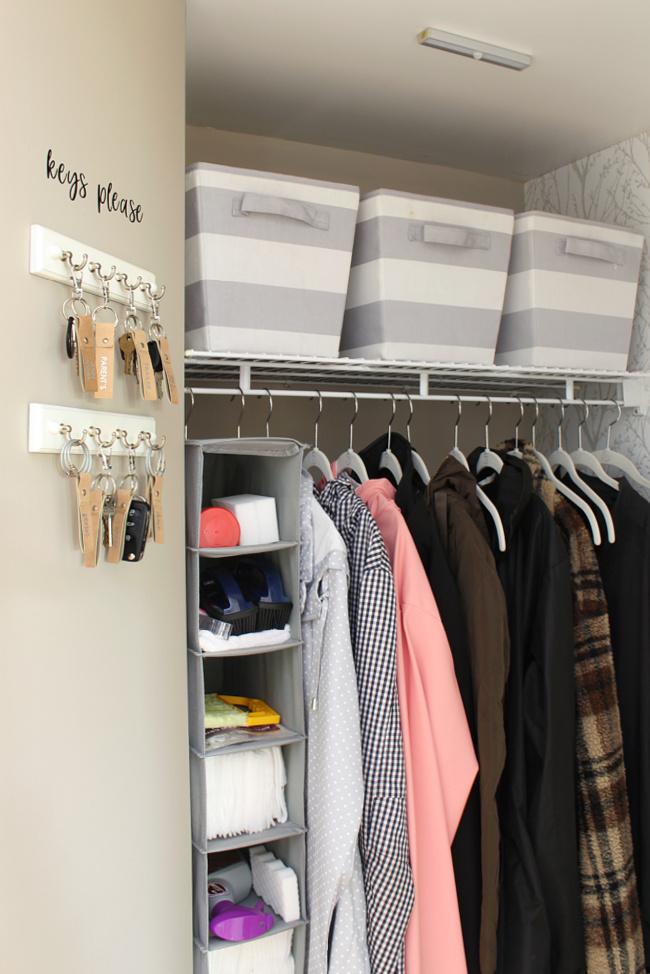 Organized front entry closet with key organizer.