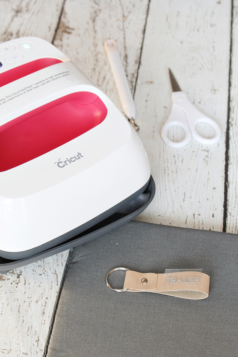 Cricut EasyPress to add iron-on vinyl to DIY keychains.