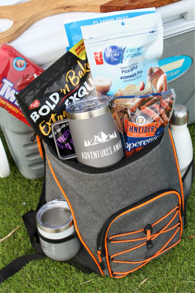 Personalized ice cooler camping gift basket.